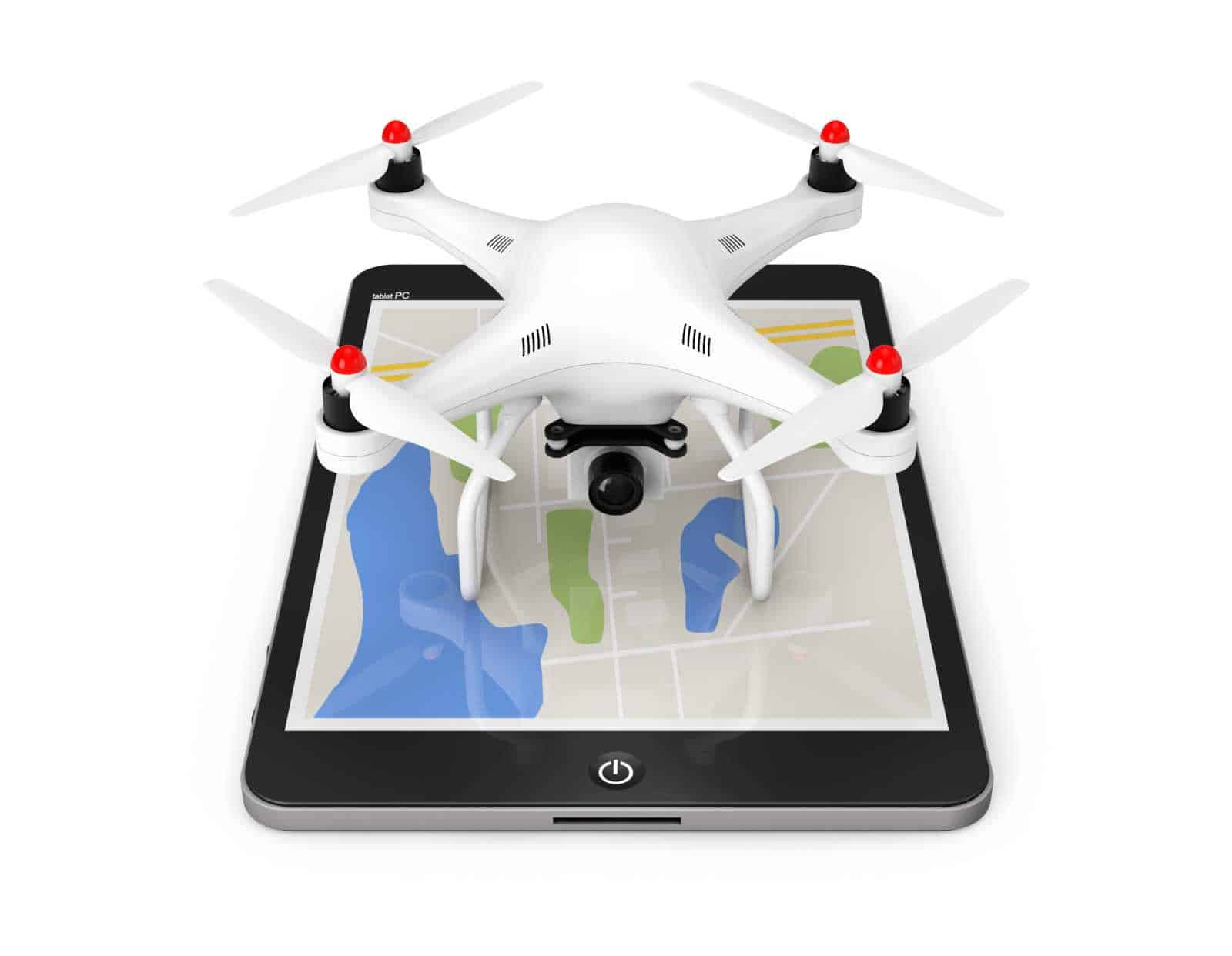 White quadcopter drone placed on an ipad