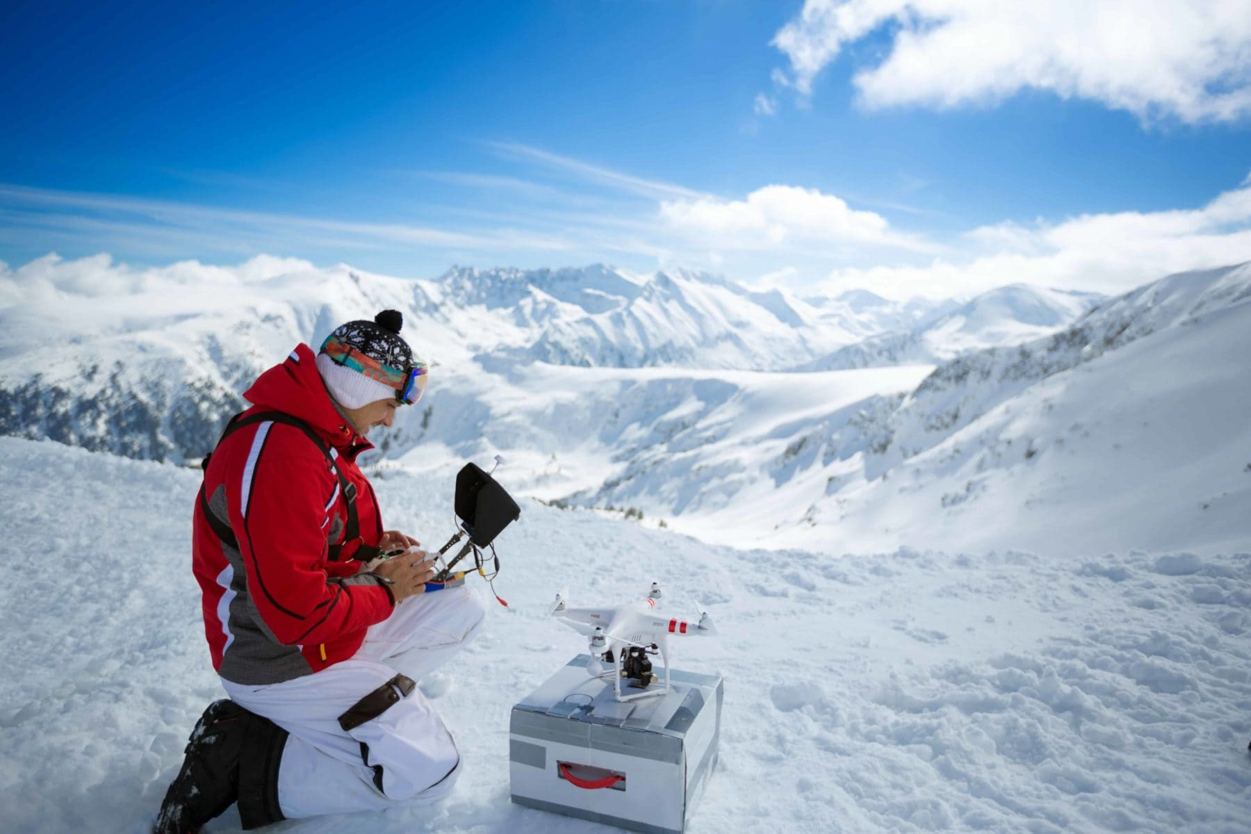 Flying Drones in Cold Weather, image of man in the snow operating a drone.