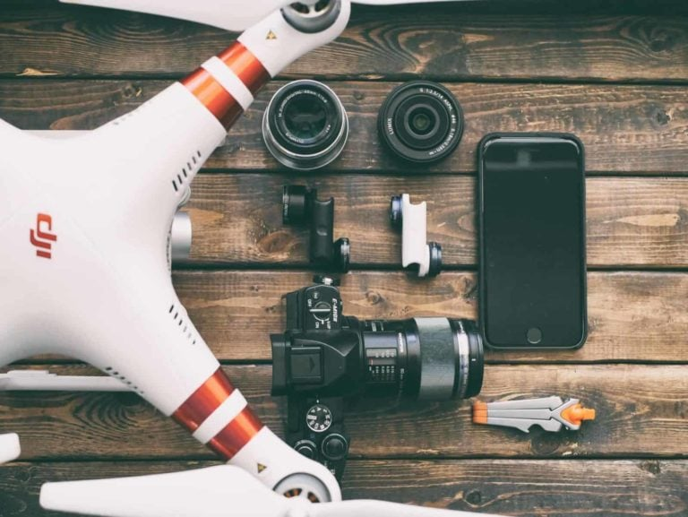 image of drone and accessories such as cameras, lenses, cell phone